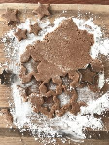 cookie dough on confection sugar dusted cutting board