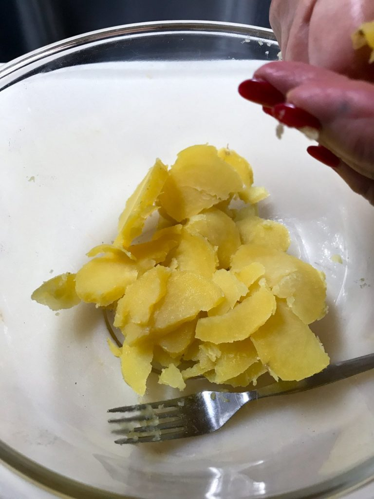 Sliced potatoes in a glass bowl