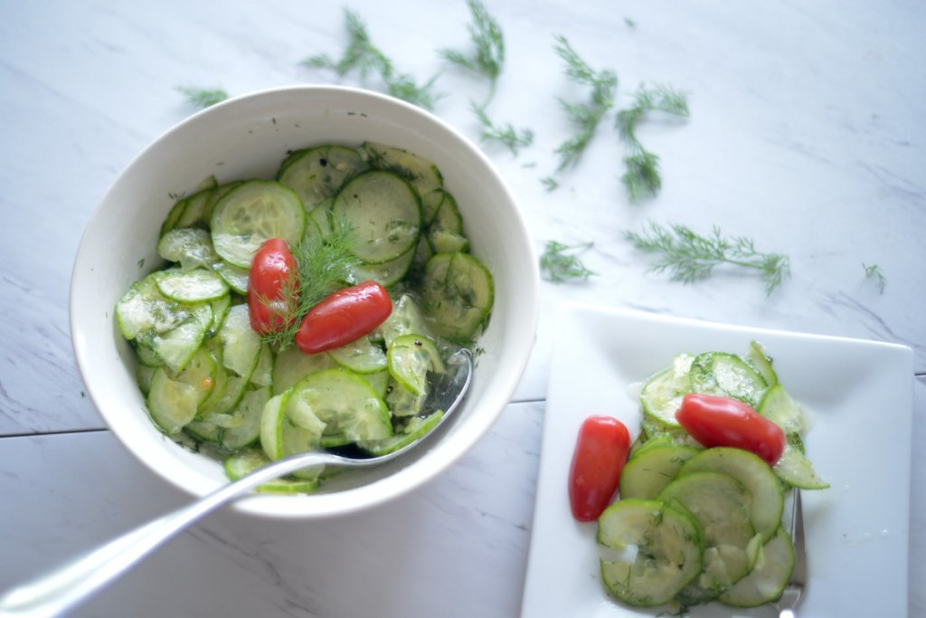 Top view of Cucumber Salad garnished with tomato