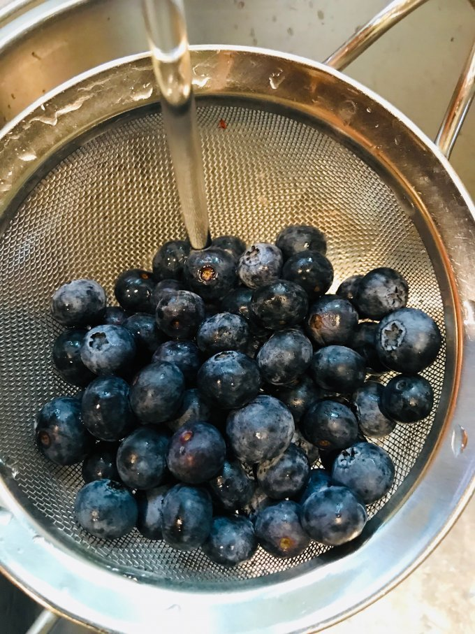 Blueberries in a wire strainer