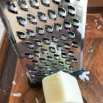 Box grater and Parmesan cheese