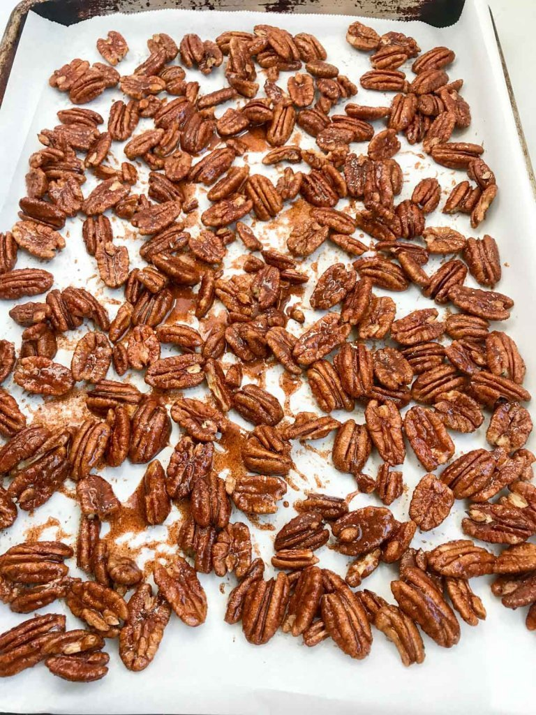 Spiced pecans on sheet pan before baking
