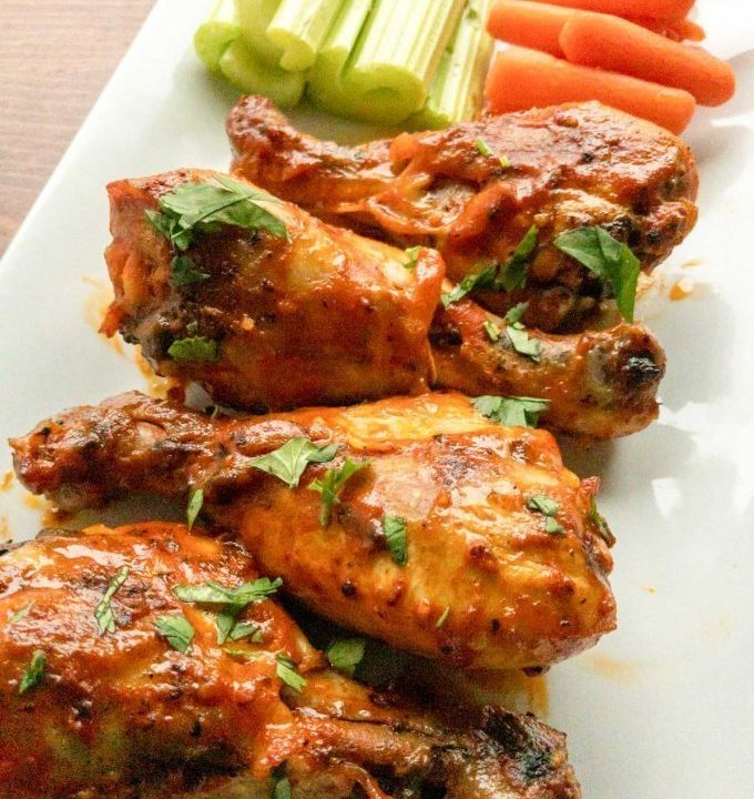 Buffalo chicken drumsticks with carrots and celery