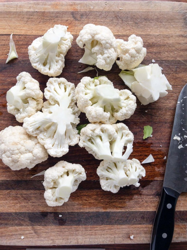 Cauliflower florets on a cutting board