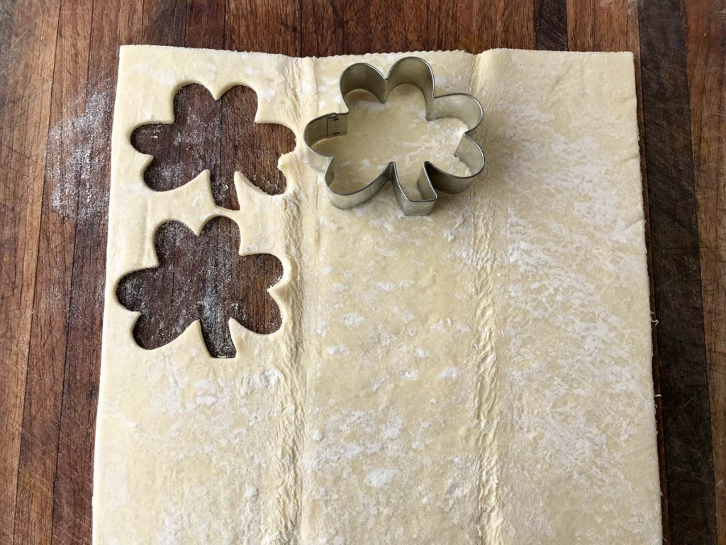 Cutting out puff pastry shamrocks