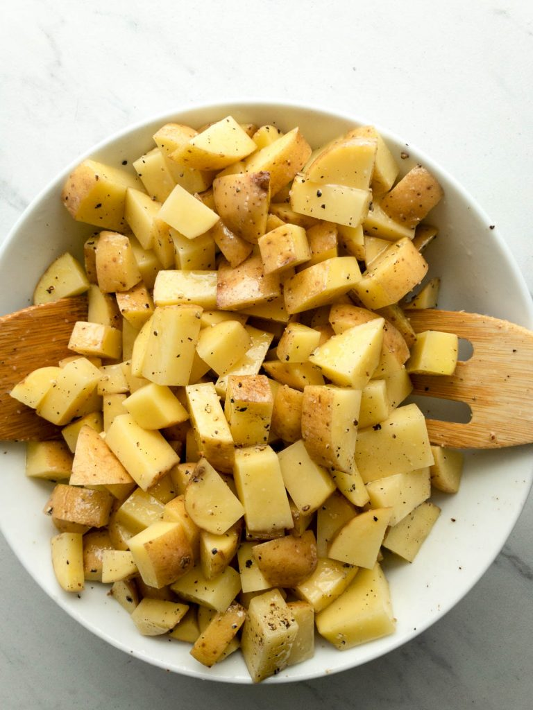 Toss potatoes