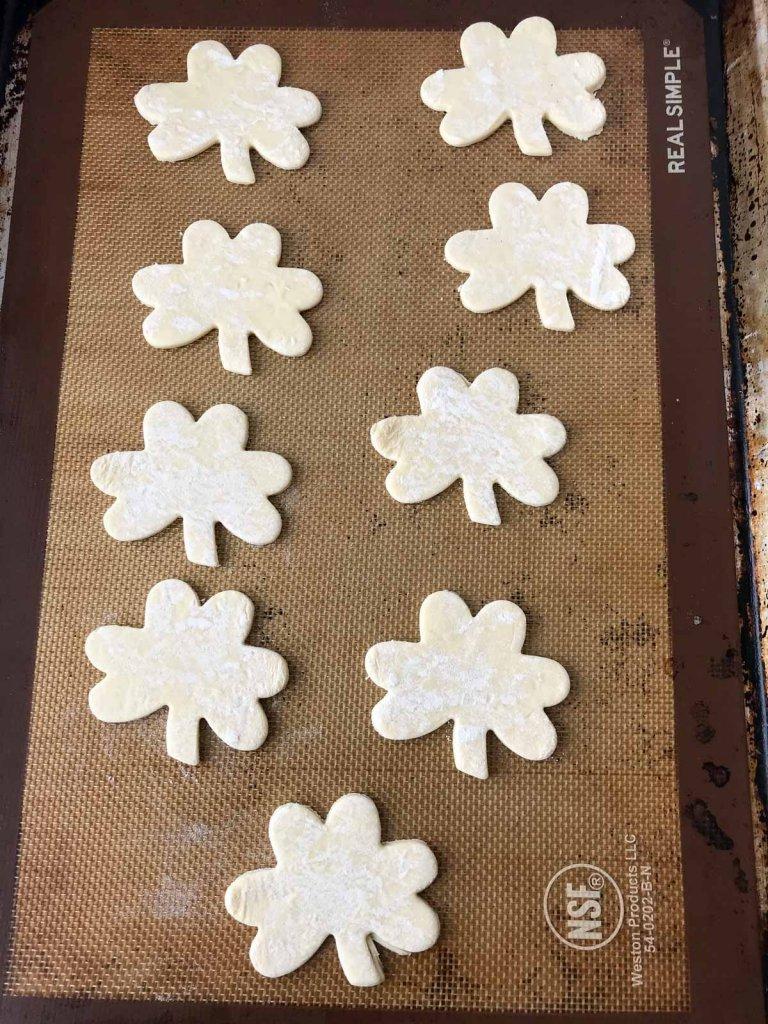 Puff pastry shamrocks on sheet pan