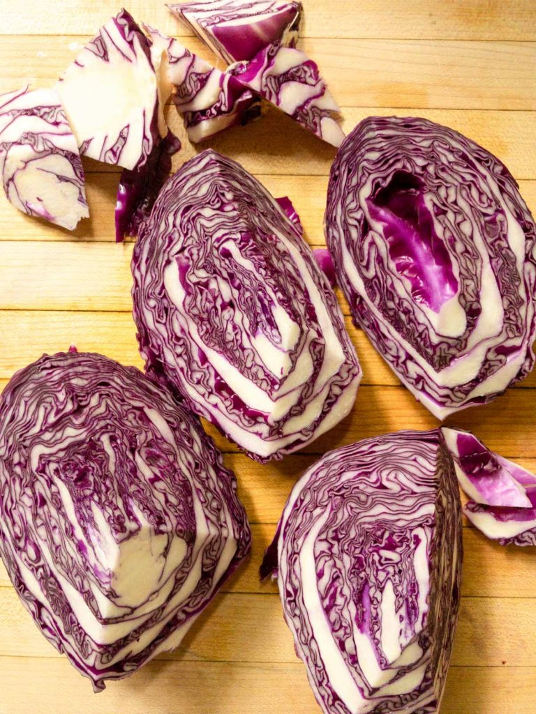 Quartered cabbage on cutting board