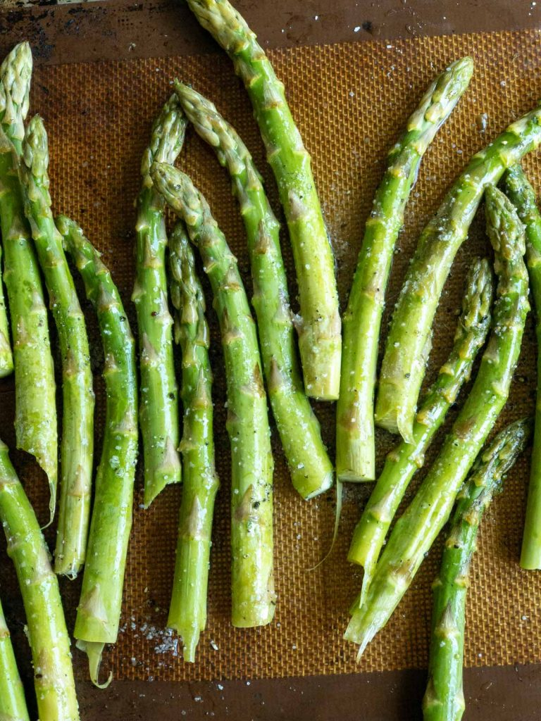 Toss asparagus to evenly distribute the seasonings and oil