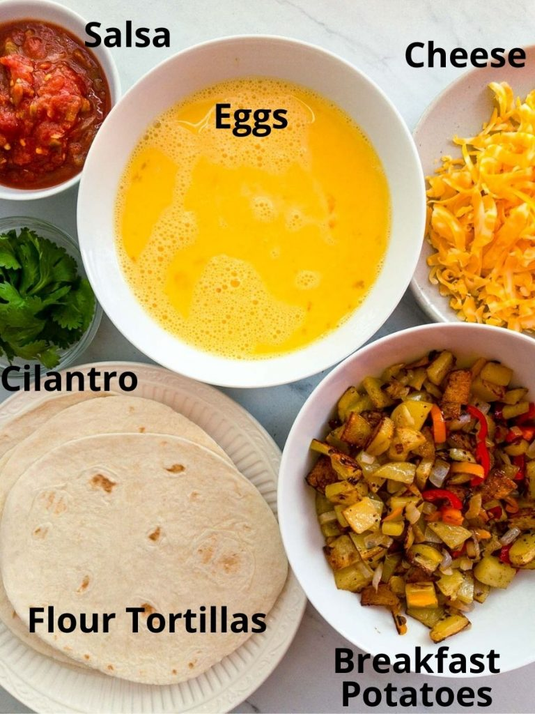 eggs, roasted potatoes, tortillas, salsa, cheese and cilantro