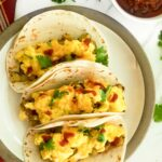Three breakfast tacos on a plate