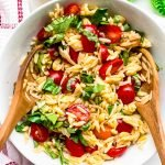 top view of orzo pasta salad with tomatoes and basil