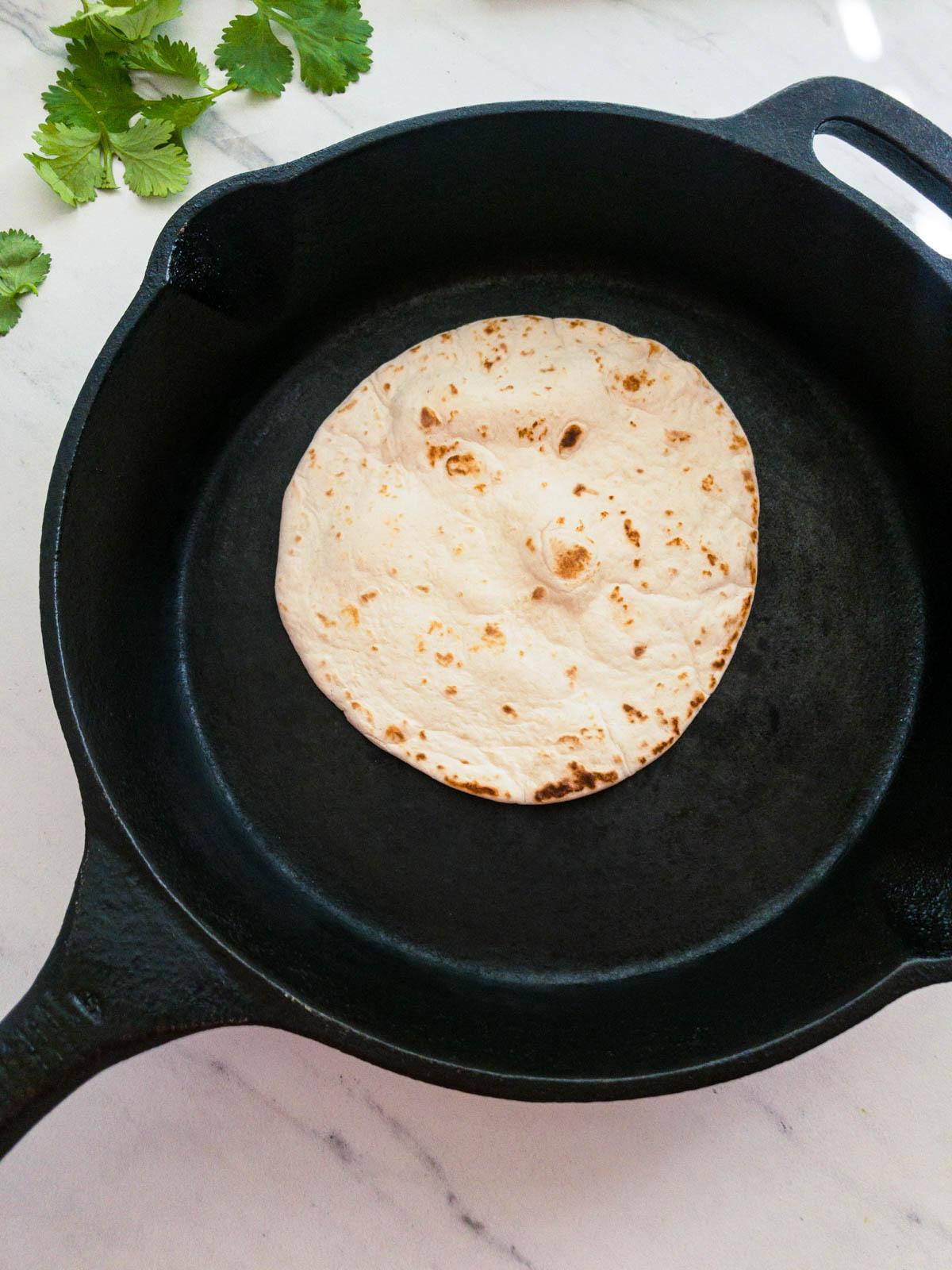 Tortilla in a cast iron pan