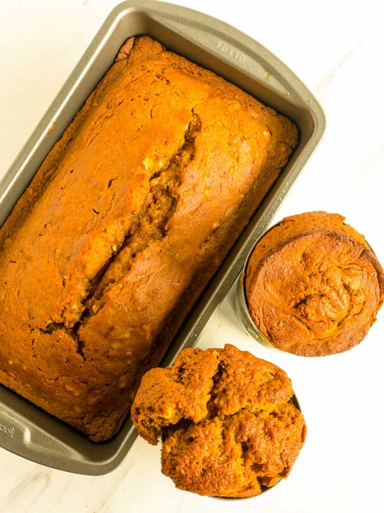 Baked pumpkin bread in loaf pan and soup can