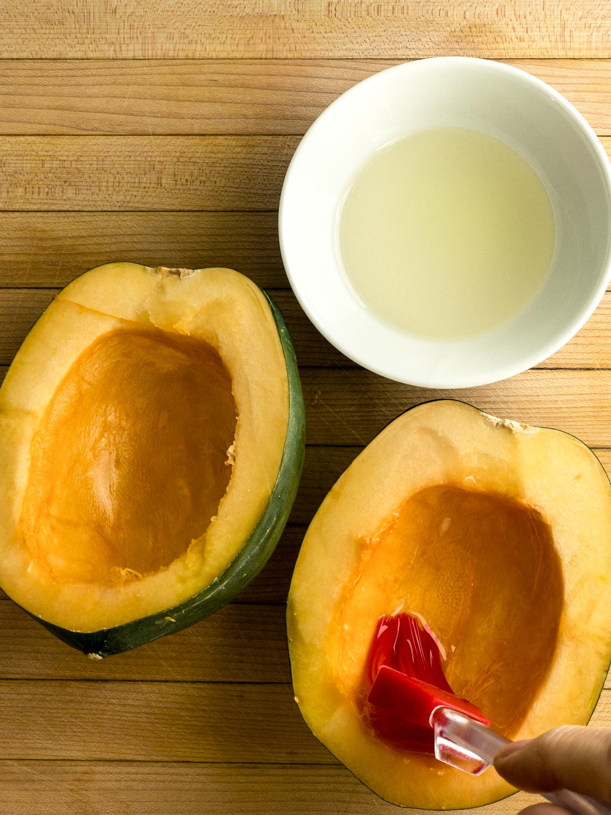 Brush oil on the skin of acorn squash
