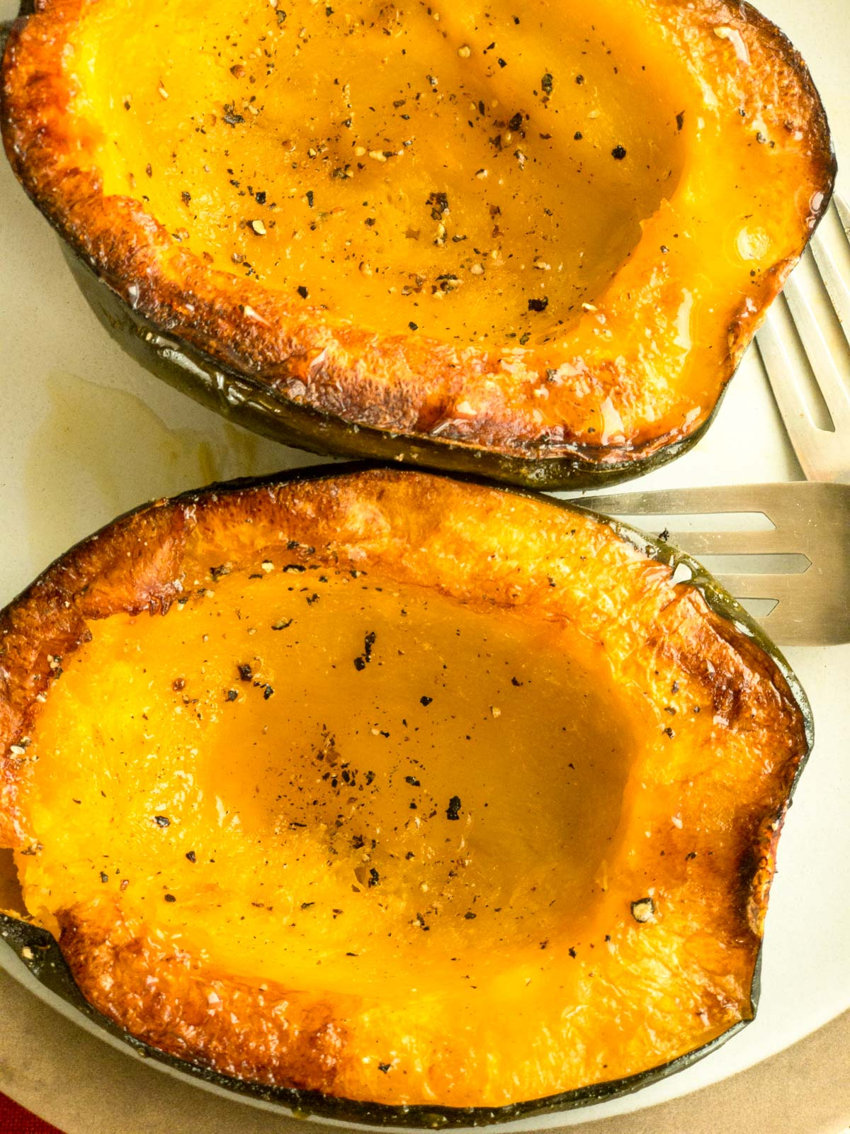 Roasted acorn squash halves on a plate