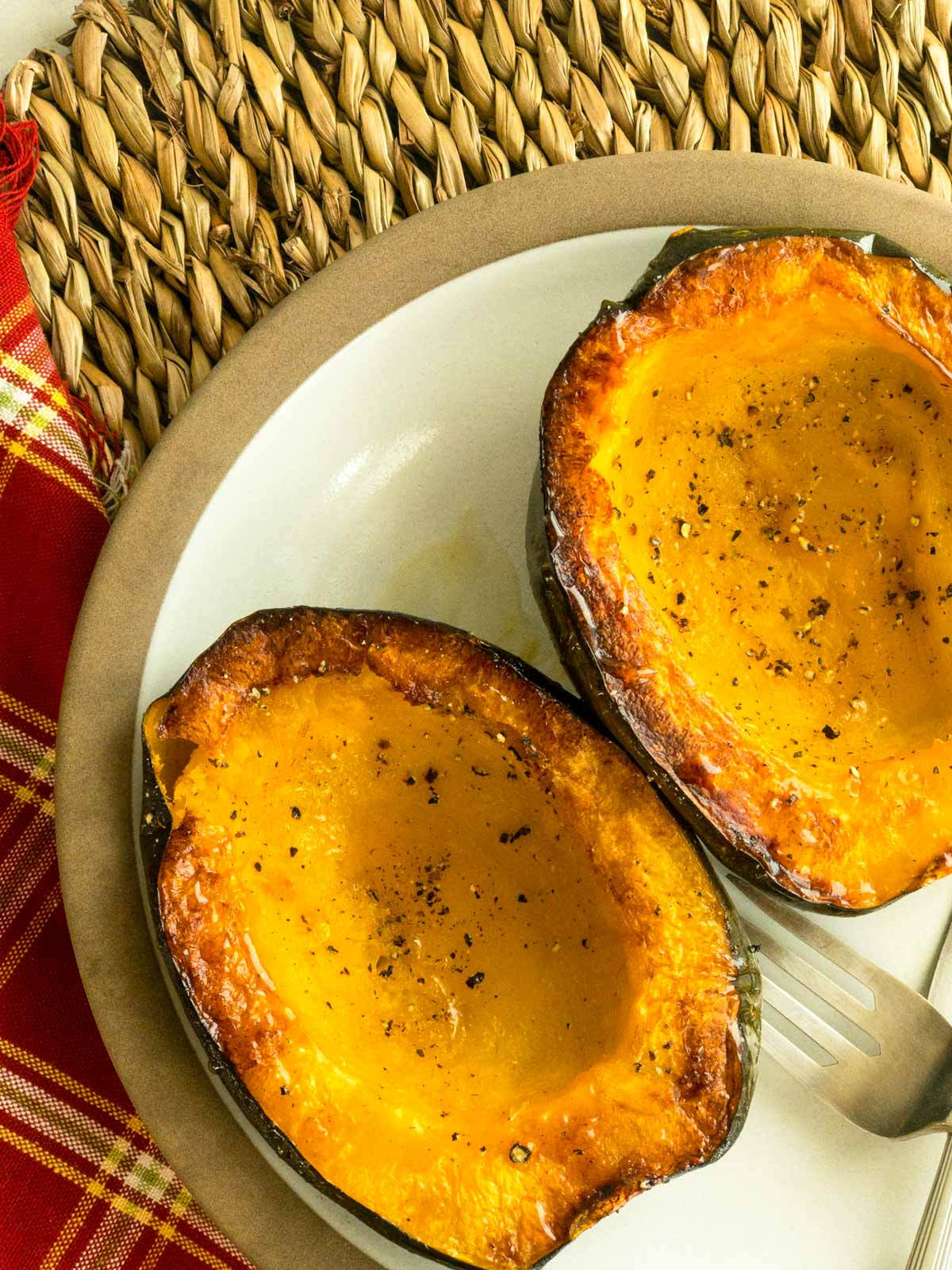 Roasted acorn squash on brown plate