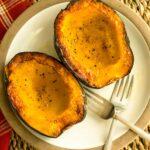 Roasted acorn squash halves on a plate