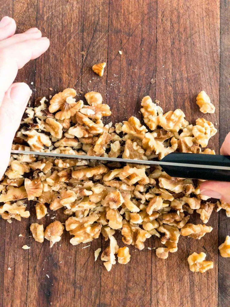 Chopping walnuts on a chopping board