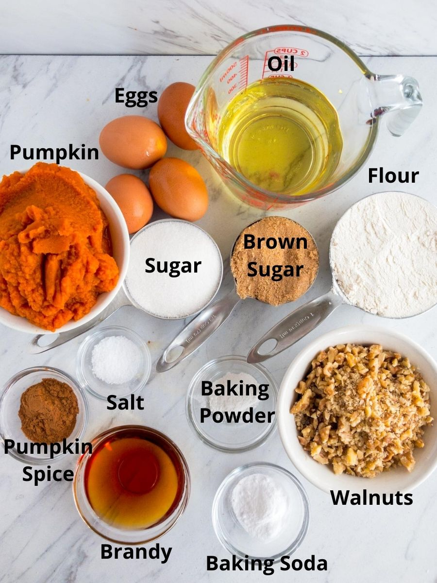 Ingredients for pumpkin bread, pumpkin, flour, sugar, oil, nuts, vanilla, baking soda and powder, salt, eggs
