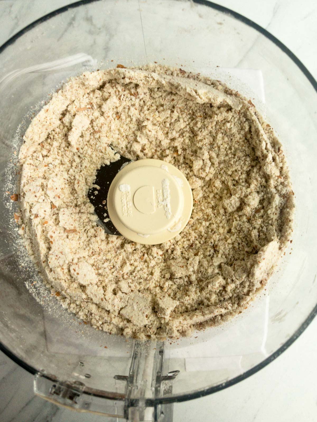 Finely groundnuts and flour in food processor bowl