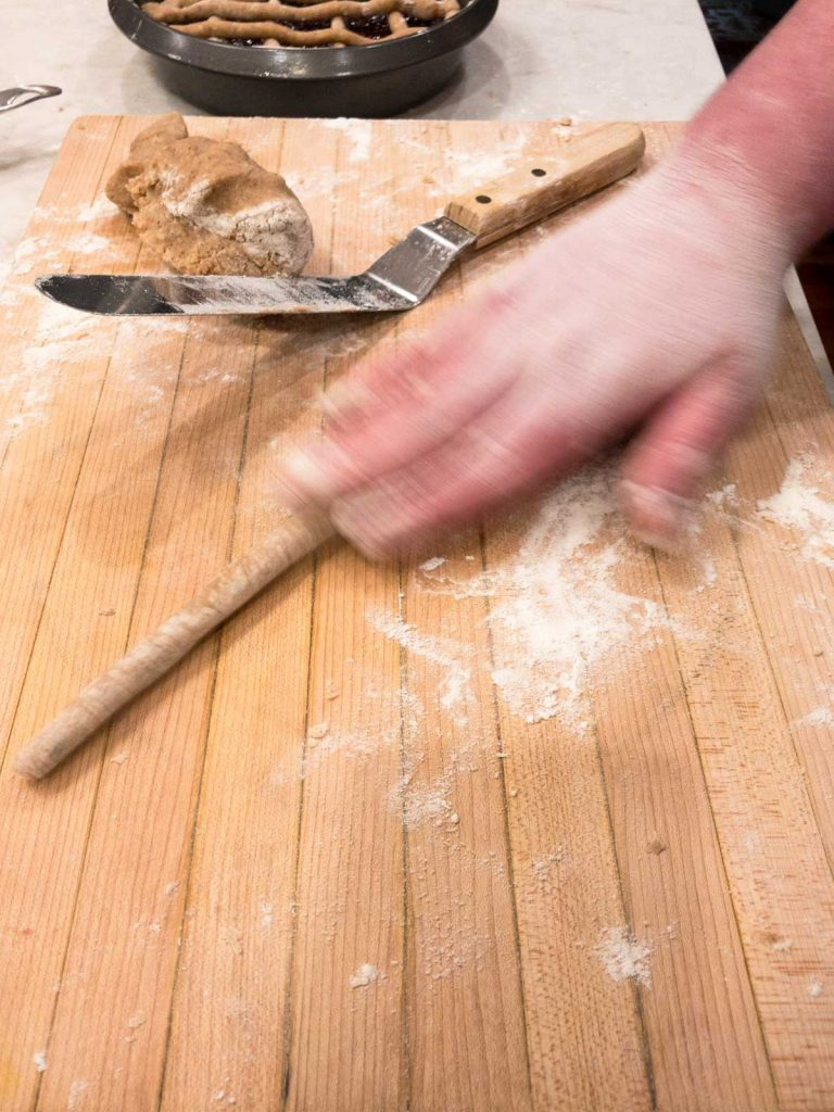 Rolling dough by hand into logs on a cutting board