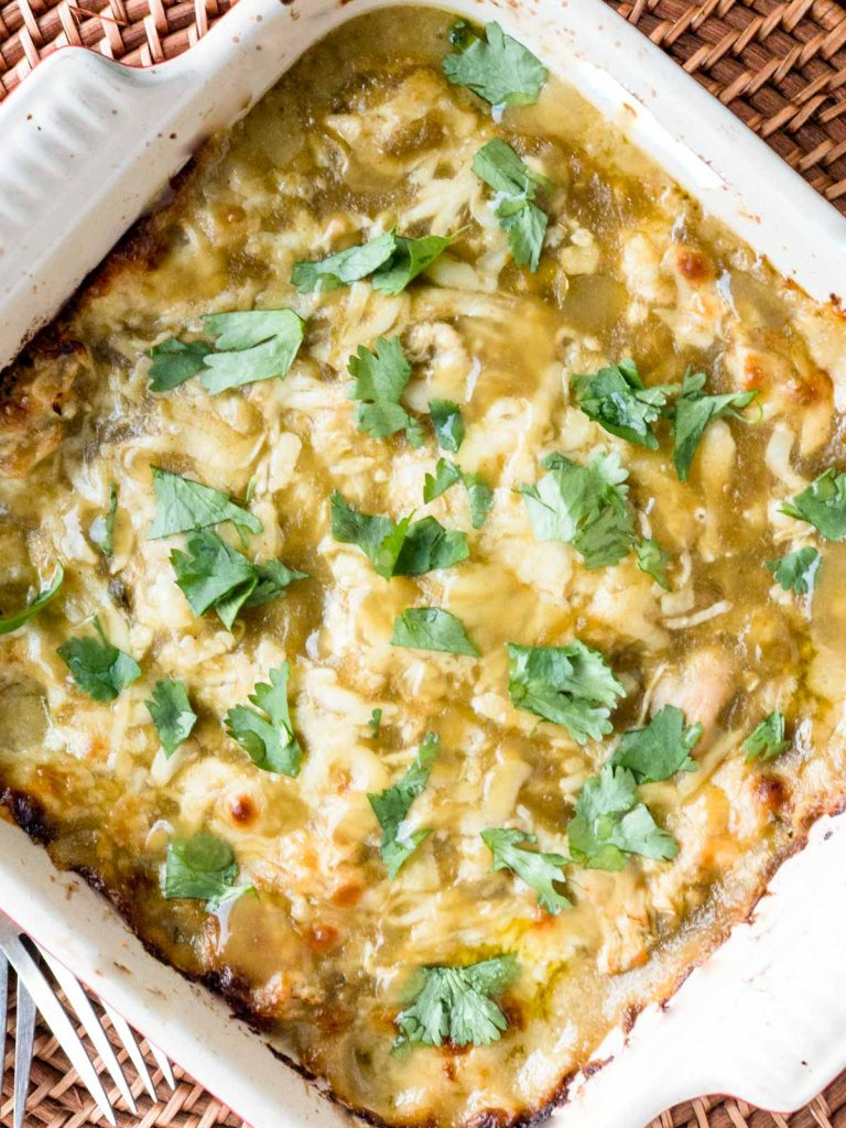 Baked Stacked green chili chicken enchilada casserole