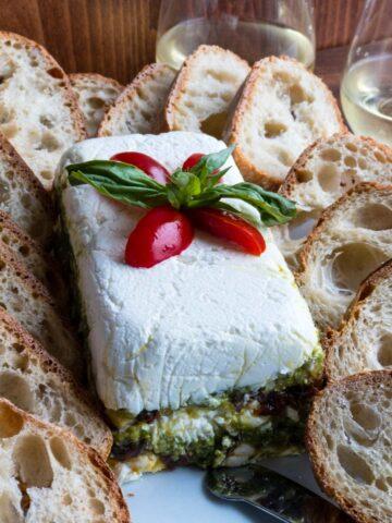 Pesto torte with bread slices