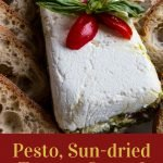Cream cheese, layered with sun-dried tomatoes and peston with bread slices