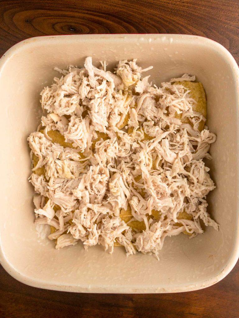 Shredded chicken in casserole dish