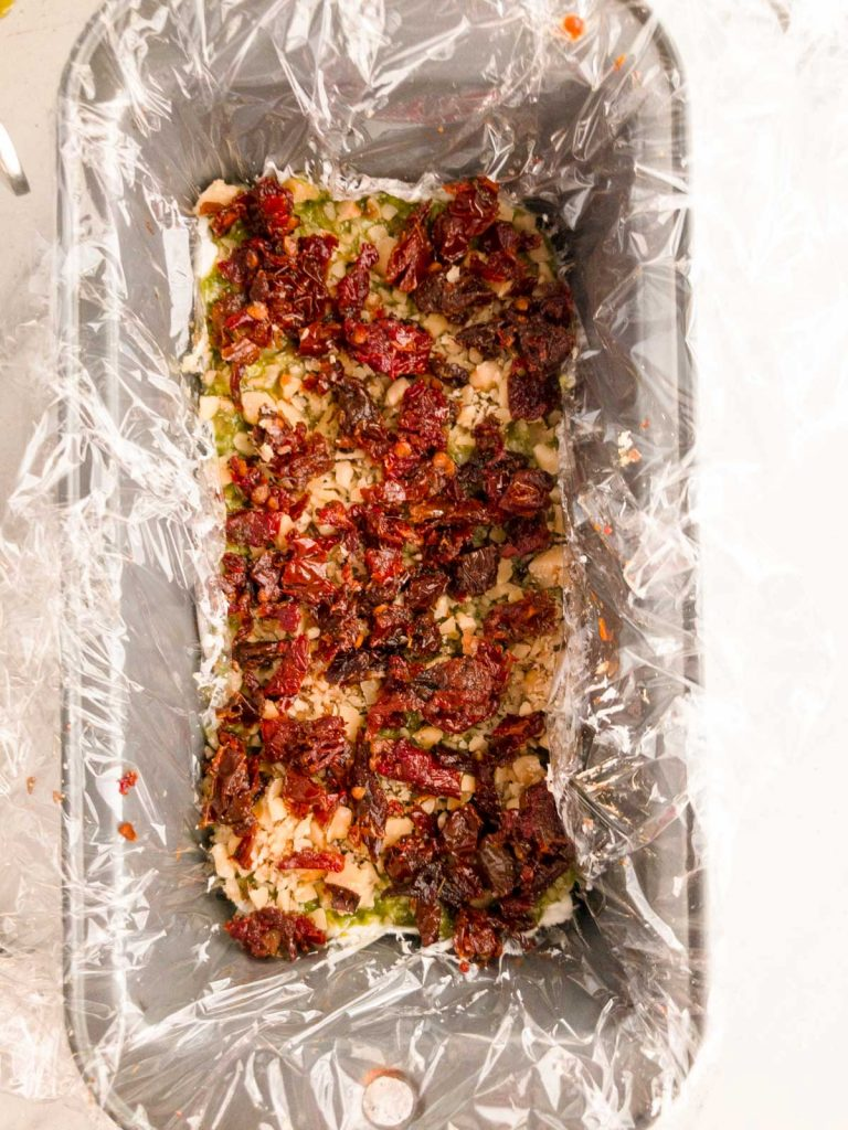 Sun-dried tomatoes on top of finely chopped walnuts
